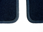 05-09 OEM Ford Mustang Floor Mats with serged edge, Corners Close up